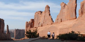 retirement-blog-senior-couple-walking-at-arches-national-park-in-utah